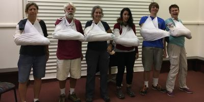 interNATIONAL PARKtours staff & friends practising their emergency splints
